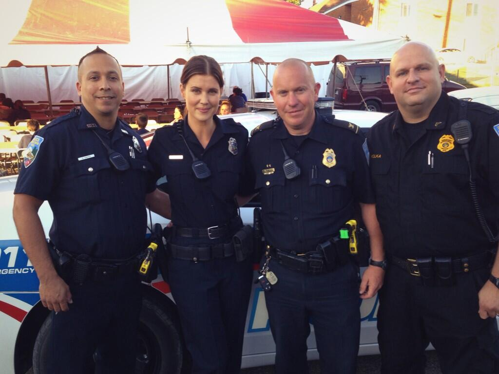 Sarah Lancaster and the Sugarcreek Police, posing during the filming of Love Finds You in Sugarcreek, Ohio